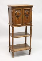 A LATE 19TH CENTURY FRENCH WALNUT MUSIC CABINET, with a pair of carved panelled doors enclosing