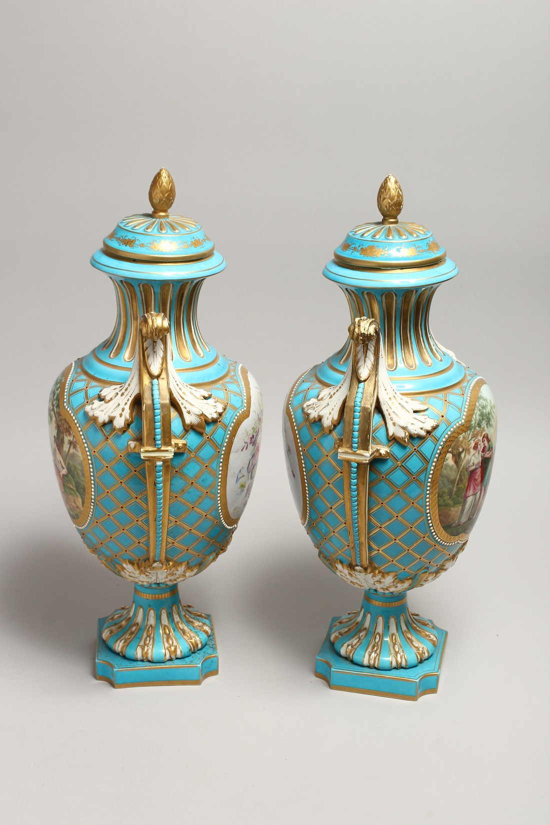 A SUPERB LARGE PAIR OF SEVRES TWO HANDLED URN SHAPED VASES AND COVERS, blue ground edged in gilt and - Image 4 of 10