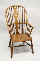 A 19TH CENTURY YEW, BEECH AND ELM WINDSOR ARMCHAIR