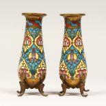 A SMALL PAIR OF GILT BRONZE AND CHAMPLEUVE ENAMEL VASES, on four scroll feet, Signed F. BARBEDIENNE.