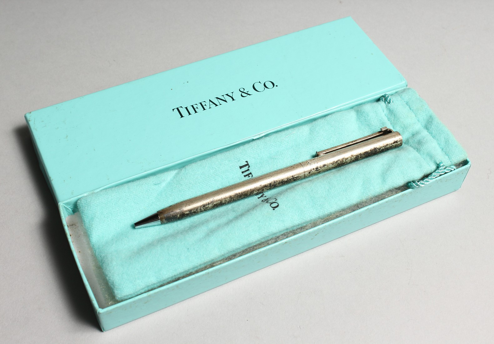 A TIFFANY SILVER PEN in a Tiffany box.