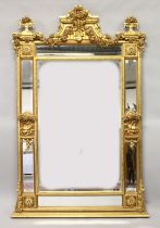 A LARGE CLASSICAL STYLE GILT FRAMED PIER MIRROR with a central rectangular mirror plate within six