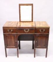 A GENTLEMAN'S GILLOWS OF LANCASTER MAHOGANY DRESSING TABLE, with rising mirror, flaps to the sides