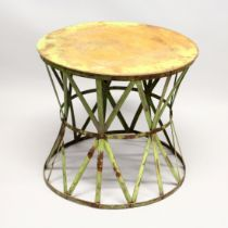 A VERY UNUSUAL METAL PAINTED CIRCULAR CIRCUS STAND for an elephant 2ft 3ins diameter, 2ft high