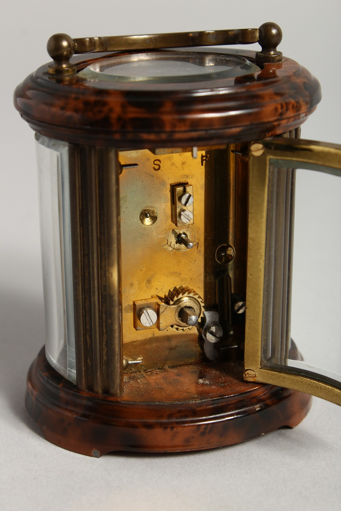 A GOOD CIRCULAR BRASS CARRIAGE CLOCK, MATTHEW NORMAN, LONDON. 3ins high - Image 4 of 7