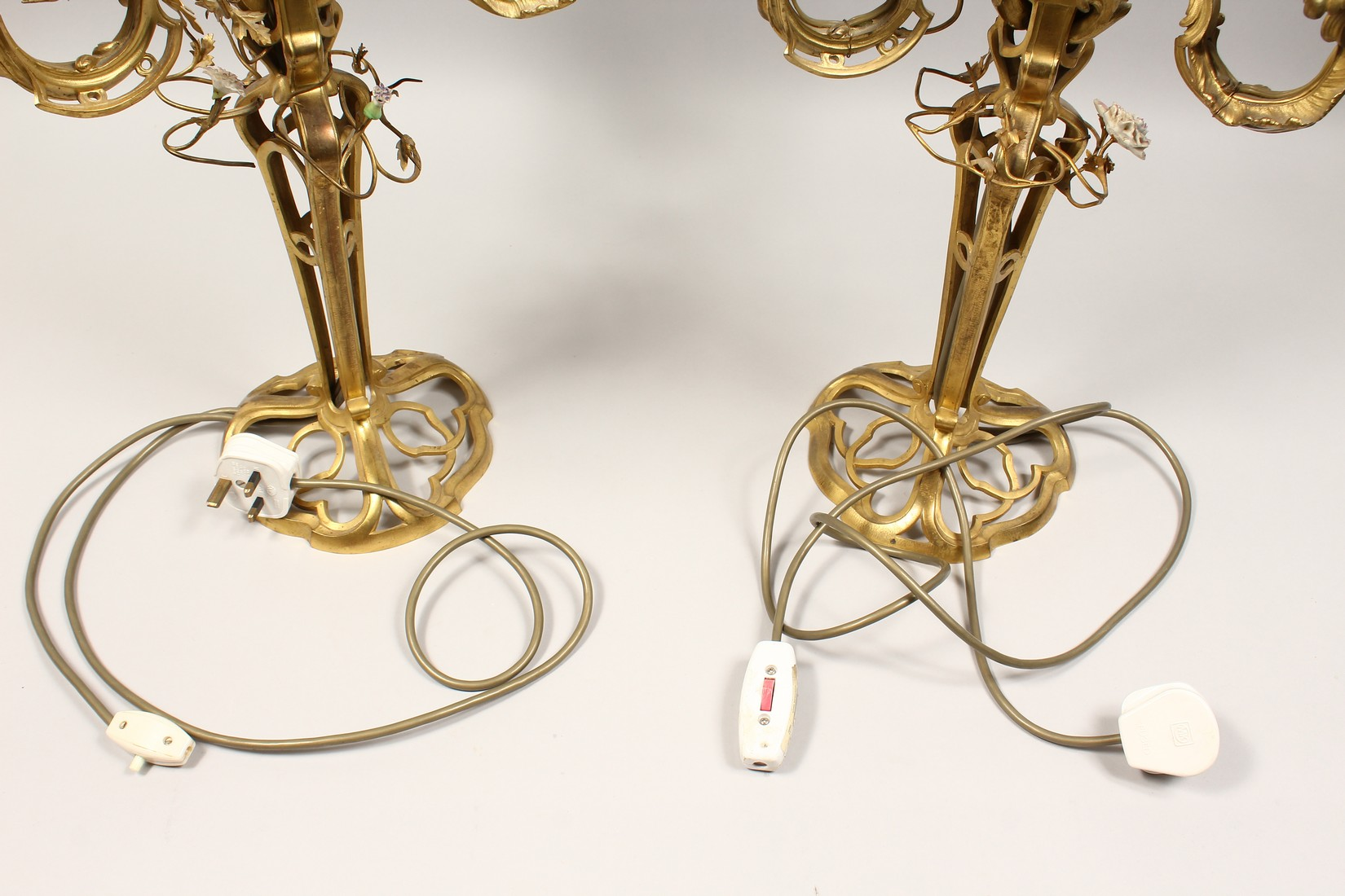 A GOOD PAIR OF FRENCH BRONZE THREE BRANCH CANDELABRA with scrolling arms and porcelain flowers 25ins - Image 5 of 5
