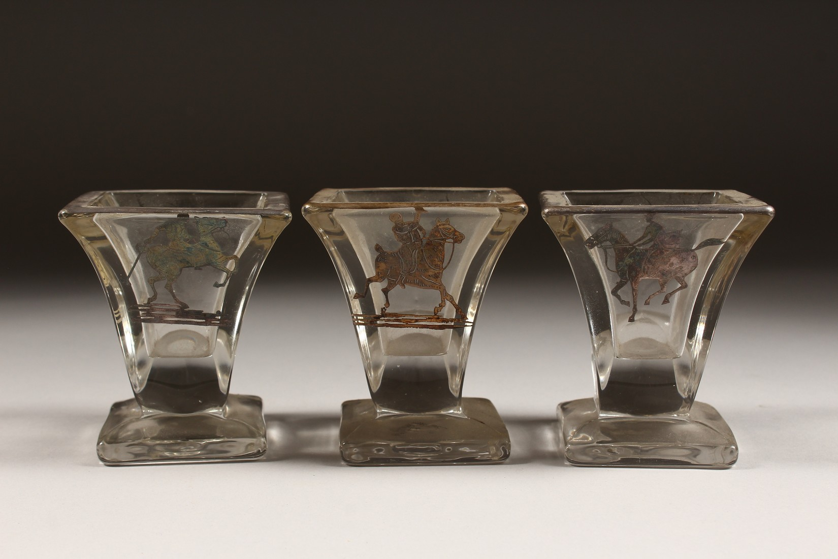 A SET OF THREE SILVER OVERLAY MOULDED GLASS SMALL VASES, decorated with polo players on horseback. - Image 2 of 5