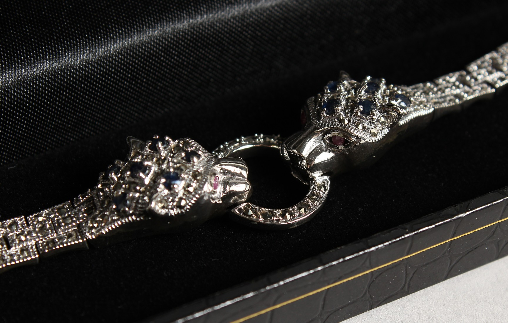 A SILVER, SAPPHIRE AND MARCASITE PANTHER BRACELET