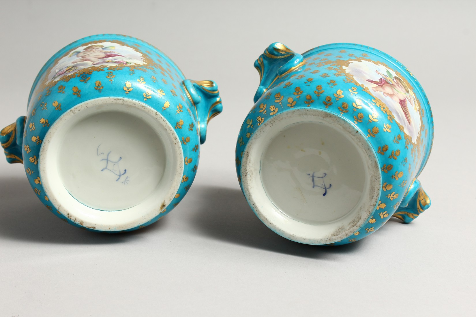 A GOOD PAIR OF SEVRES PORCELAIN CACHE POTS, blue groun painted with reverse panels of fruit. Mark in - Image 6 of 6