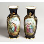 A SUPERB LARGE PAIR OF SEVRES PORCELAIN VASES rich deep blue, painted with a large panel of girls,