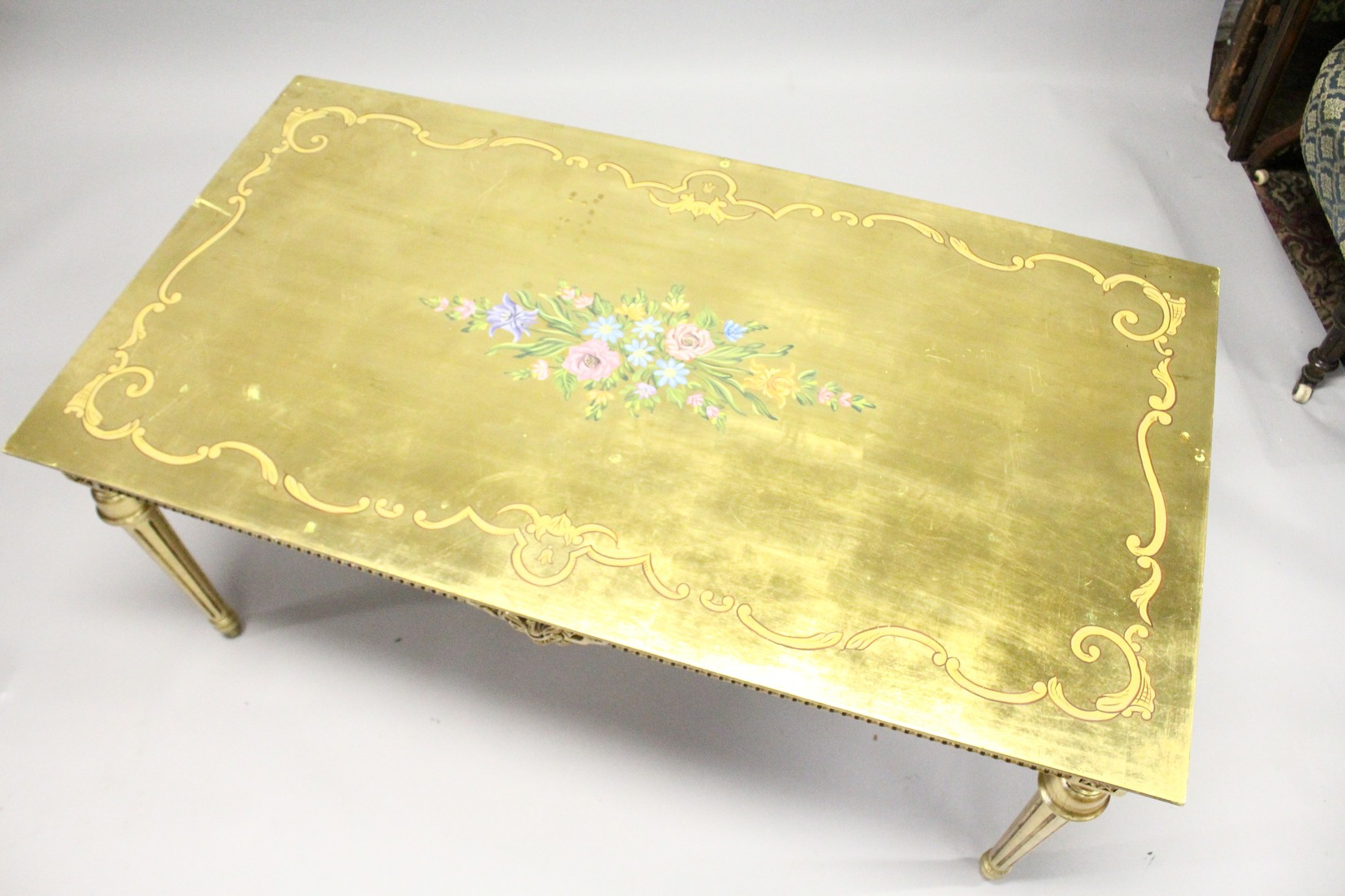 A 20TH CENTURY DECORATIVE GILTWOOD LOW TABLE, with floral painted decoration, on turned tapering - Image 2 of 6