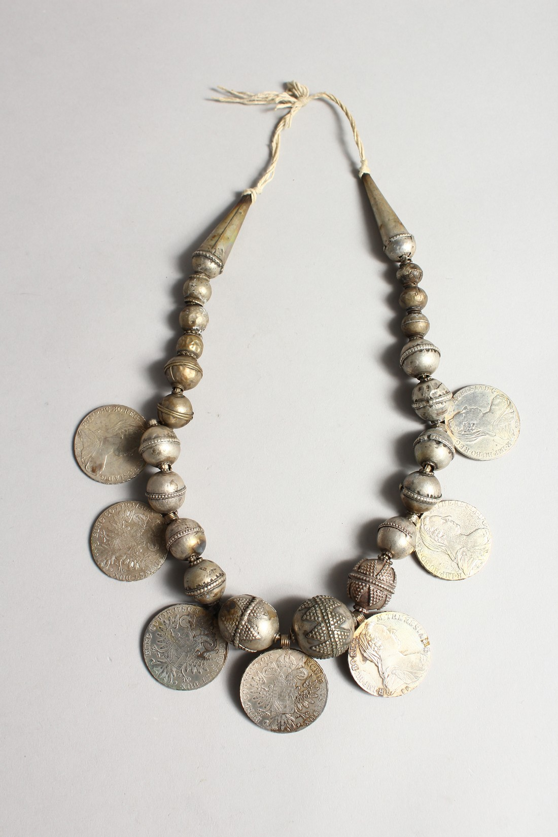 AN ISLAMIC SILVER NECKLACE with seven coins. - Image 2 of 2