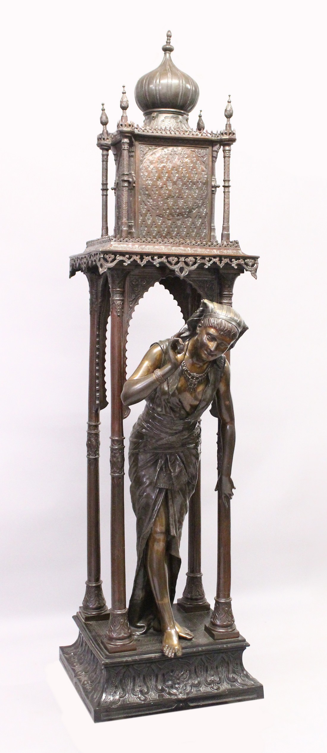 A SUPERB LARGE 19TH CENTURY FRENCH BRONZE OF AN ISLAMIC YOUNG LADY standing in an arbour with four