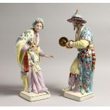 A PAIR OF PORCELAIN FIGURES OF A CHINESE MAN AND WOMAN ON SQUARE BASES 15ins high