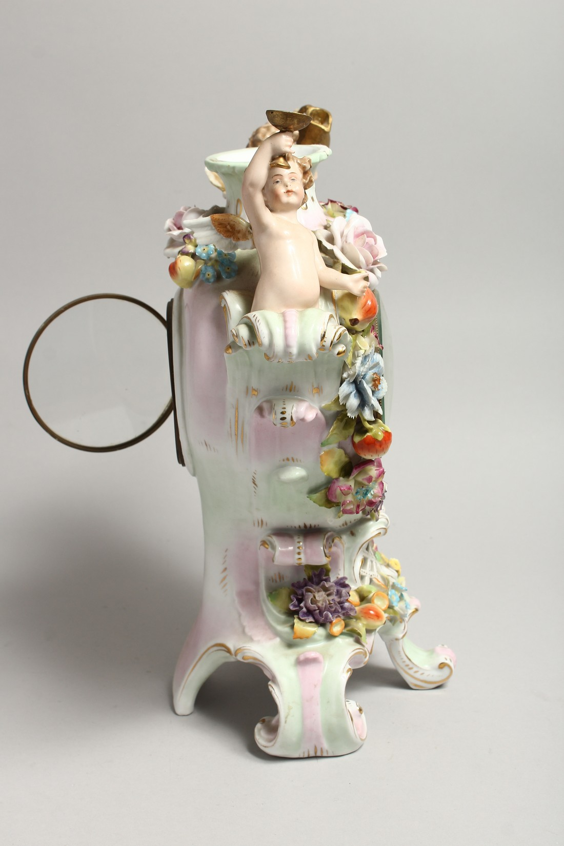 A CONTINENTAL PORCELAIN CUPID AND FLOWER ENCRUSTED CLOCK, with blue and white Roman numerals. - Image 4 of 7