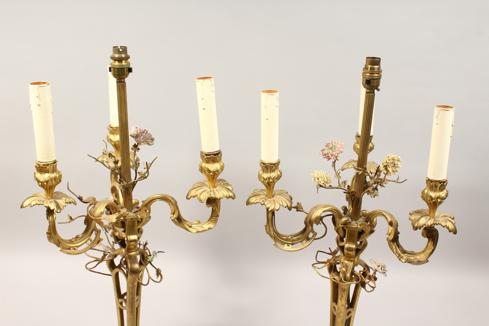 A GOOD PAIR OF FRENCH BRONZE THREE BRANCH CANDELABRA with scrolling arms and porcelain flowers 25ins - Image 2 of 5
