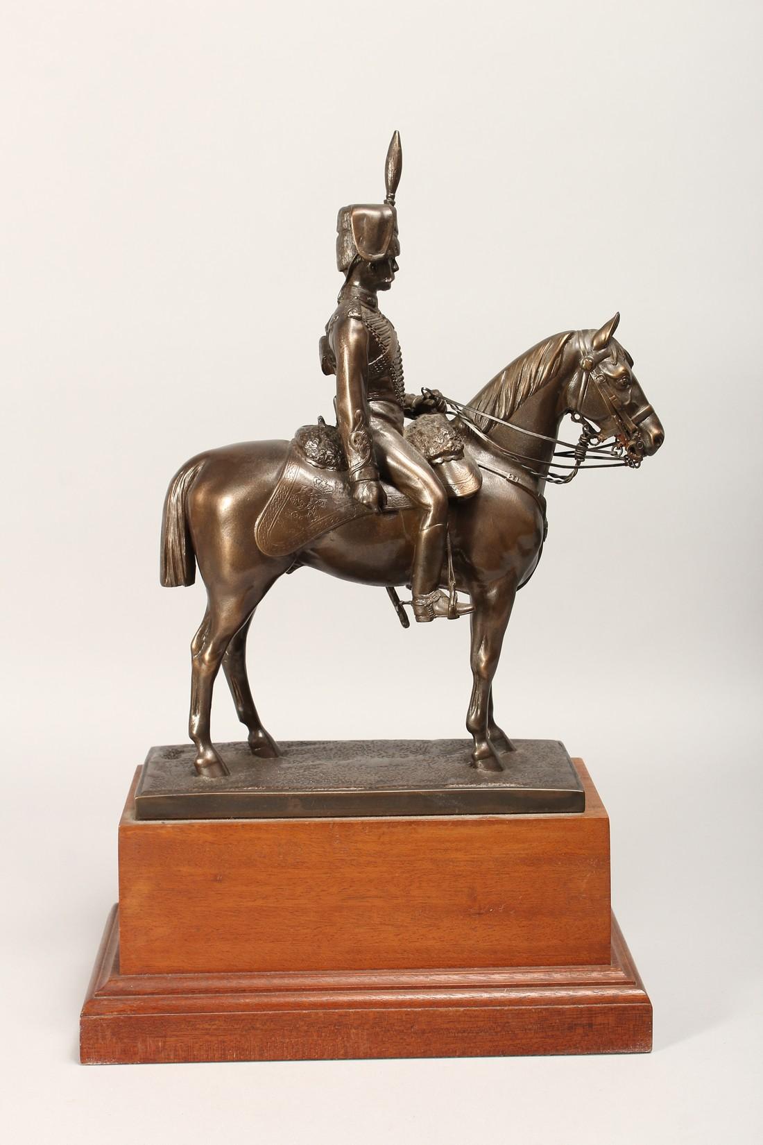 A BRONZE OVERLAID COMPOSITE MODEL OF A HUSSAR ON HORSEBACK, on a wooden plinth base 17ins high. - Image 3 of 4