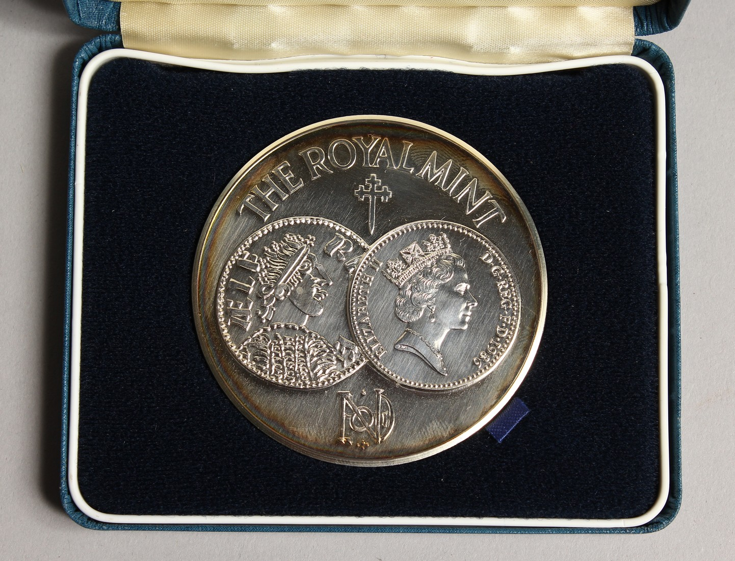 ONE HUNDRED YEARS IN MINTING, SILVER PROOF MEDALLION in a box issued by the Royal Mint, no.886