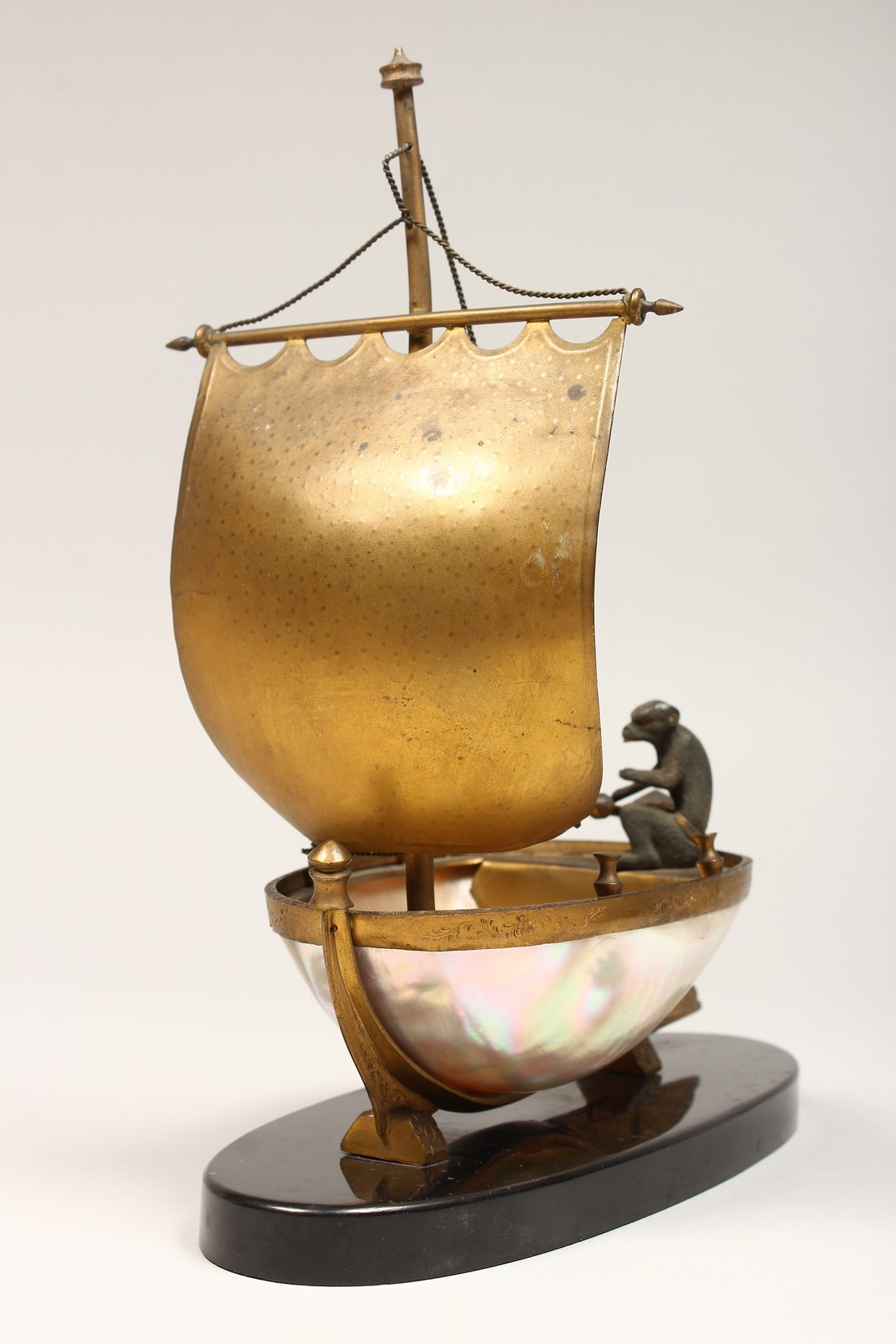 AN UNUSUAL LATE 19TH CENTURY FRENCH ORMOLU MOUNTED SHELL, mounted as a small sailing dinghy, a - Image 6 of 6
