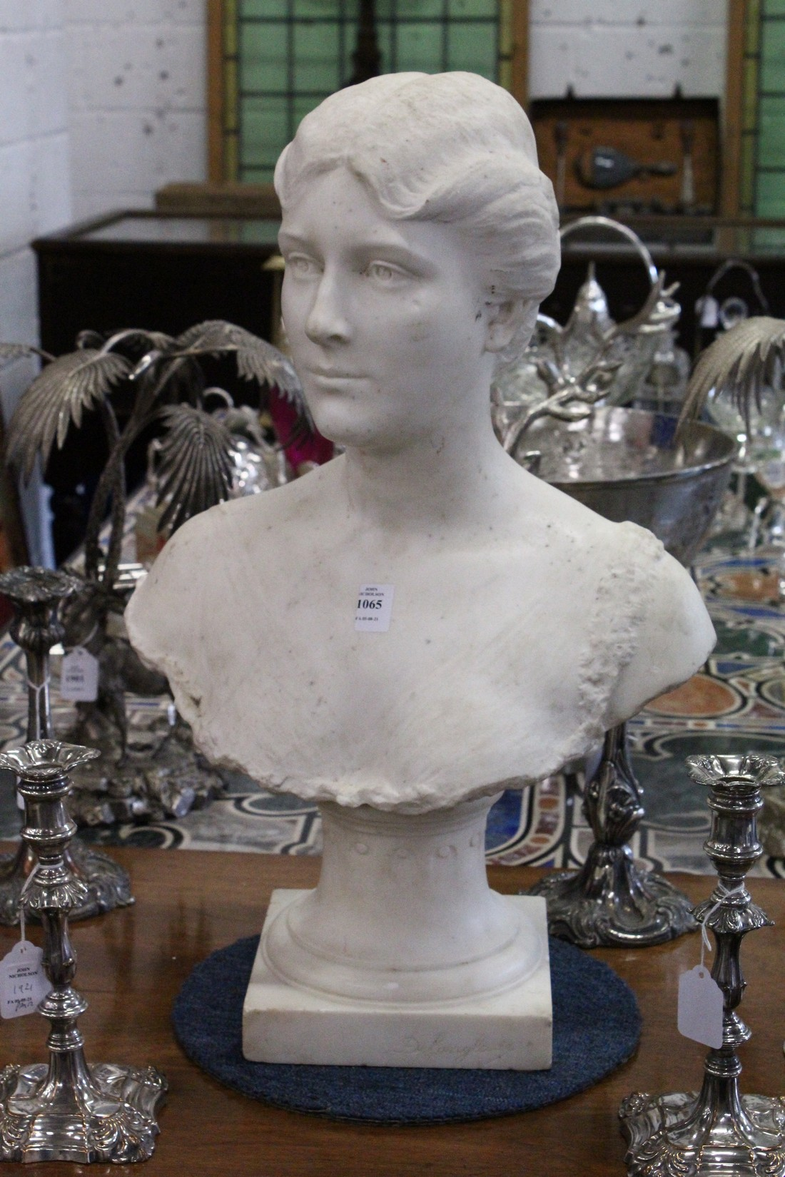 A GOOD 19TH CENTURY CARVED WHITE MARBLE BUST OF A LADY, ON A STAND. 2ft high.
