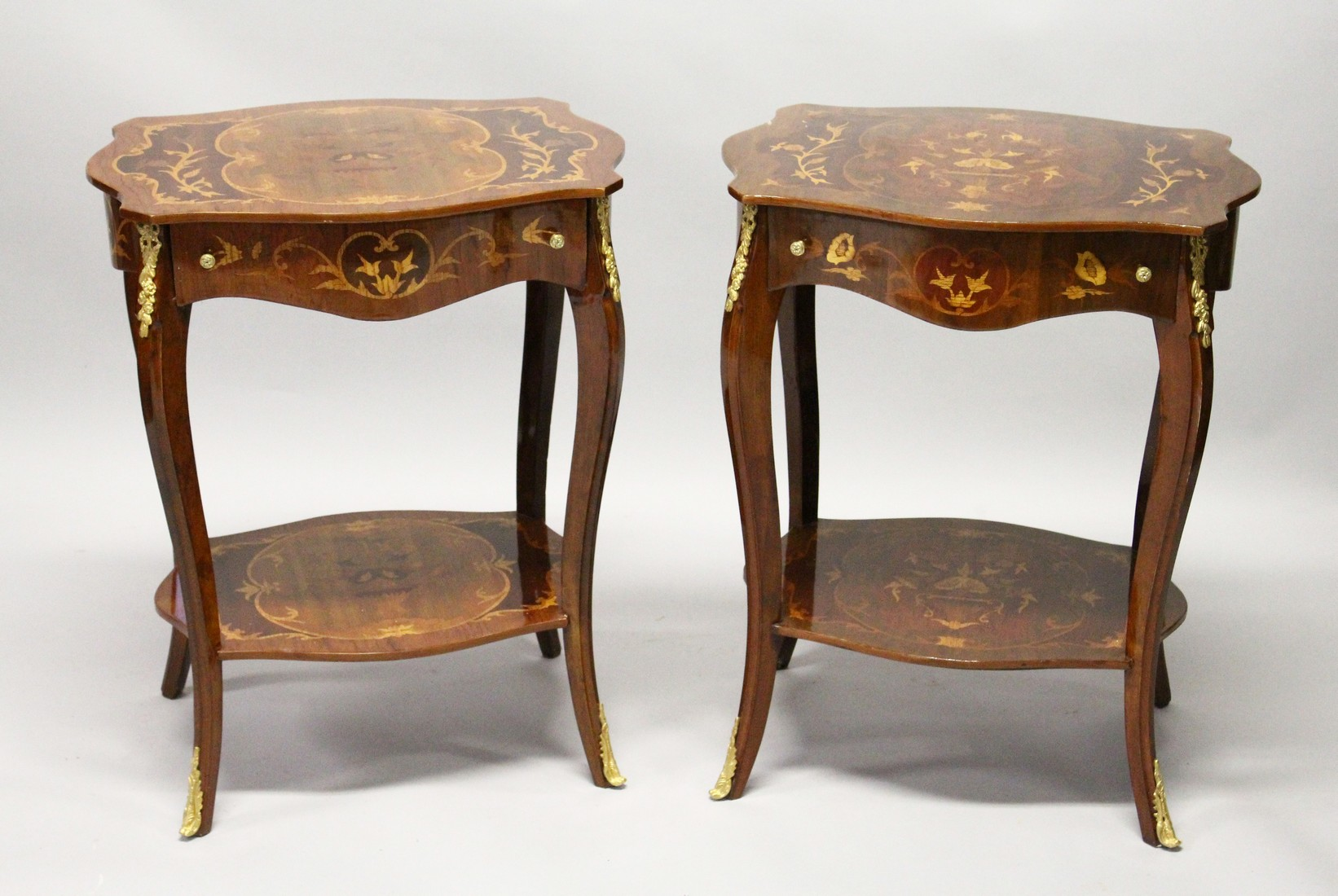 A PAIR OF FRENCH STYLE MARQUETRY INLAID TWO TIER SINGLE DRAWER SIDE TABLES, with cabriole legs 1ft
