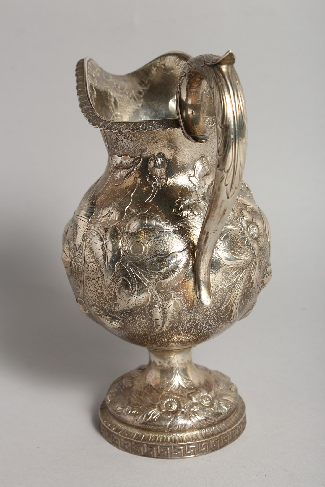 AN R & W WILSON 19TH CENTURY PHILADELPHIA SILVER JUG repousse with flowers and scrolls 8ins high, - Image 4 of 8