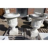 A VERY GOOD PAIR OF ITALIAN CARVED WHITE MARBLE CAMPAGNA URNS ON STANDS 2ft 5in high, stand 2ft
