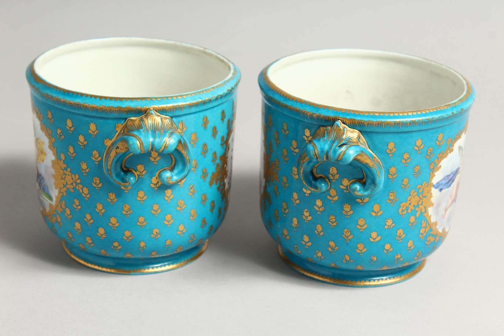 A GOOD PAIR OF SEVRES PORCELAIN CACHE POTS, blue groun painted with reverse panels of fruit. Mark in - Image 2 of 6