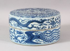 A CHINESE BLUE AND WHITE PORCELAIN CIRCULAR BOX AND COVER, the exterior painted with dragons and