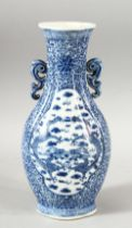 A CHINESE BLUE & WHITE PORCELAIN TWIN HANDLE VASE, decorated with panels of dragons and clouds