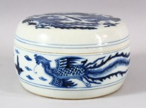 A CHINESE BLUE AND WHITE PORCELAIN CIRCULAR BOX AND COVER, the exterior painted with phoenix, the