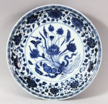 A CHINESE BLUE AND WHITE PORCELAIN DISH, painted with flowers, with six character mark to base, 27.