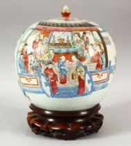 A GOOD CHINESE FAMILLE ROSE PORCELAIN JAR AND COVER on a hardwood stand, the jar painted with