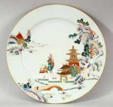A GOOD 19TH CENTURY CHINESE PORCELAIN PLATE, with enamelled decoration depicting a temple and