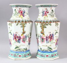 A PAIR OF CHINESE FAMILLE ROSE PORCELAIN HEXAGONAL PORCELAIN VASES - each vase of hexagonal form,