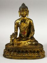 A GOOS SINO TIBETAN GILT BRONZE FIGURE OF BUDDHA / DEITY - in a seated pose holding flora, the
