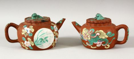 TWO CHINESE YIXING CLAY TEAPOTS WITH POLY CHROME DECORATION- the pots decorated depicting panels