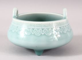 A GOOD SMALL CHINESE TURQUOISE GLAZED PORCELAIN CENSER, with twin handles and supported on three