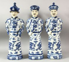 THREE LARGE CHINESE BLUE & WHITE PORCELAIN EMPEROR FIGURES, each stood with decorated robes with
