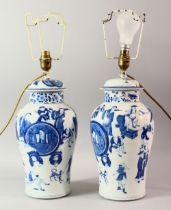 A PAIR OF CHINESE BLUE AND WHITE PORCELAIN JARS AND COVERS converted to lamps, both decorated with