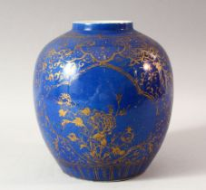 A CHINESE BLUE GROUND AND GILT DECORATED JAR, the body painted with panels of flowers, floral motifs