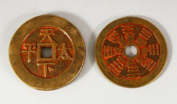TWO CHINESE CURRENCY COINS - with residual poly chrome decorations 5.6cm & 6cm