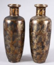 A PAIR OF UNUSUAL CHINESE METALLIC GLAZE PORCELAIN VASES, the bases with blue four character mark,