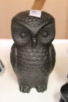 A cast iron model of an owl.