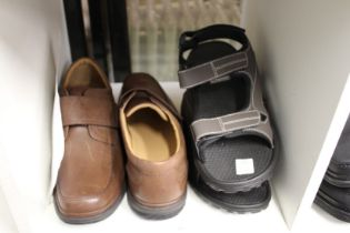 A new pair of gentlemen's size 10 Clark's shoes and a pair of sandals.