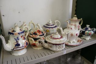 19th century lustre decorated teapots, sucriers and stands.
