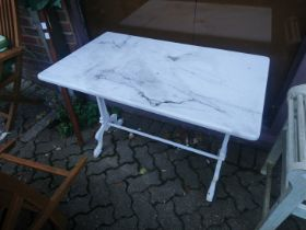A cast iron and marble top table.