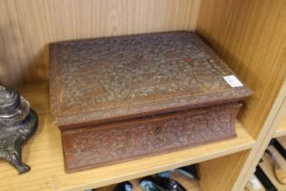 A carved eastern box containing four smaller boxes and a lift-out tray.