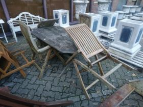 A garden table and four folding armchairs.