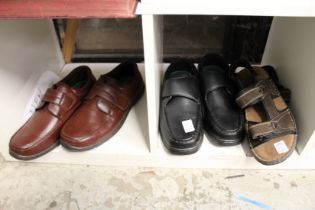 Two new pairs of gentlemen's size 11 shoes and a pair of sandals.